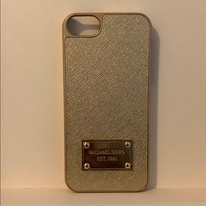 Gold snap on Michael Kors case